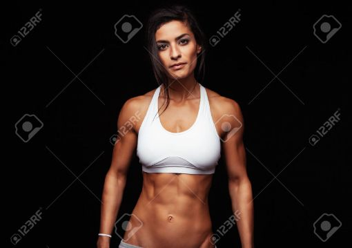 42096248-Portrait-of-fit-young-woman-posing-wearing-sports-bra-against-black-background-Determined-sportswoma-Stock-Photo