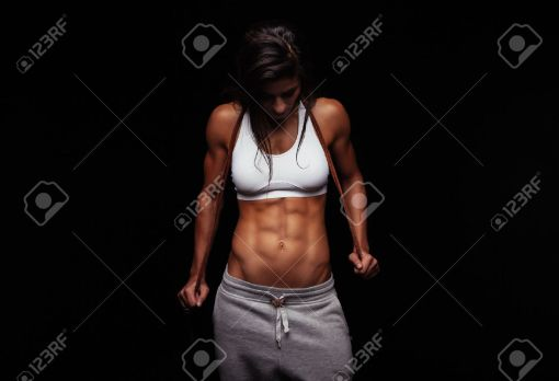 43375487-Portrait-of-muscular-woman-holding-jumping-rope-Female-fitness-model-with-skipping-rope-on-black-bac-Stock-Photo